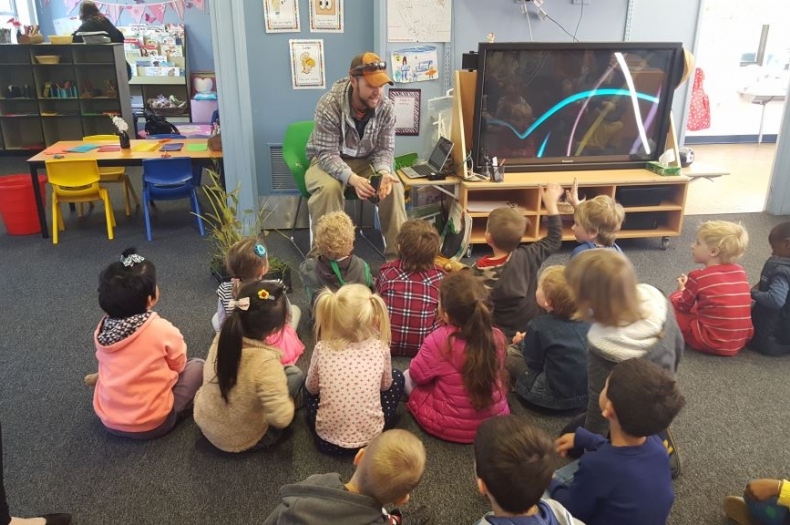 Adam teaching Merribyrnong preprimary school about Indigenous culture and bushtucker.